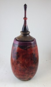 Turned sycamore urn with fire colors